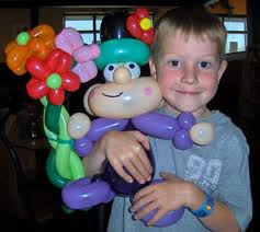 balloon twisting boy